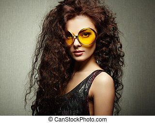 Portrait of beautiful woman in sunglasses on white background