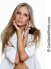 Portrait of beautiful woman in white shirt