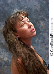 portrait of beautiful woman looking to side