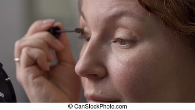 Portrait of beautiful woman making make-up