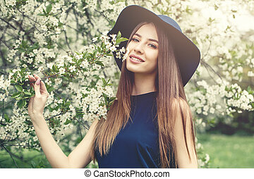 Portrait of beautiful woman on blossom background