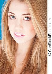 Portrait of beautiful woman on blue background