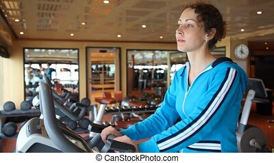 woman on exercise bicycle - portrait of beautiful woman on...