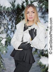 Portrait of beautiful woman posing in winter