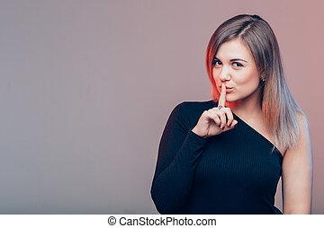 Portrait of beautiful woman, she doing quiet gesture