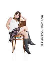 Beautiful Woman Sitting On Chair