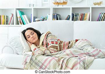 Portrait of beautiful woman sleeping on sofa