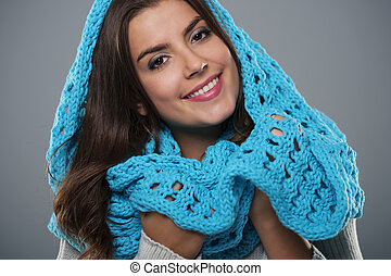 Portrait of beautiful woman wearing big blue scarf
