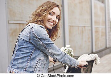 Portrait of beautiful woman with bike