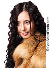 Portrait of beautiful woman with curly hair wearing fur -...