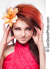 Portrait of beautiful woman with flower in hair on white