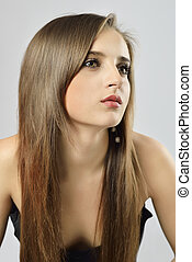 Portrait of Beautiful Woman with healthy gloss long hair.