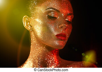Portrait of beautiful woman with sparkles on her face -...