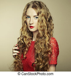 Portrait of beautiful woman with red hair in red dress
