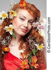 Portrait of beautiful woman with spring flowers
