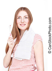 Woman with towel and toothbrush