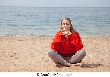 Portrait of beautiful woman Yogi on the beach