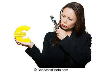 Portrait of beautiful worried woman surveying euro
