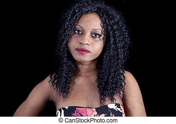 portrait of beautiful young african american girl wearing an elegant dress