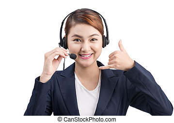 Portrait of beautiful young asian female customer service representative in headset looking at camera and smiling while isolated on white