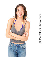 beautiful young asian woman smiling with arms crossed against isolated white background
