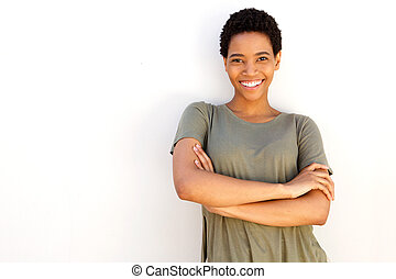 beautiful young black woman smiling against white wall