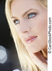 Portrait of Beautiful Young Blond Woman With Blue Eyes