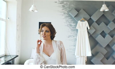 Portrait of beautiful young bride posing and smiling into camera Woman pose to photographer