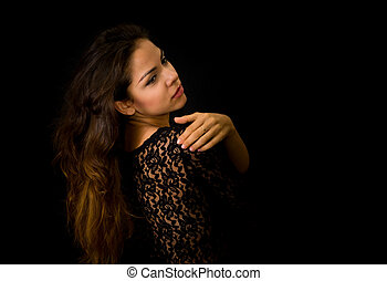 Portrait of beautiful young girl in black