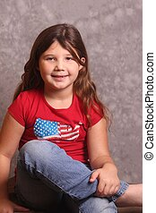 portrait of beautiful young girl in jeans and red shirt
