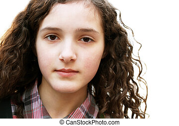 Portrait of beautiful young girl in the city