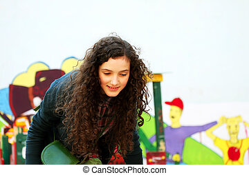 Portrait of beautiful young girl on the playground .