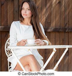 Portrait of beautiful young girl posing outside.