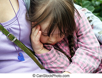 Portrait of beautiful young girl sleeping in the park .