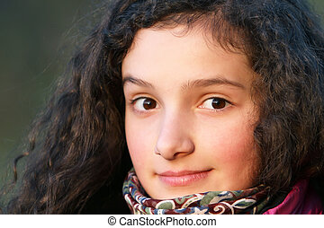 Portrait of beautiful young girl .