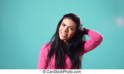 Portrait of beautiful young girl with long black hair. Slow motion.