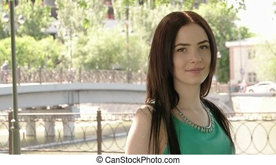 Portrait of beautiful young happy smiling casual woman outdoors with copyspace