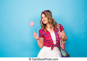 Portrait of beautiful young hippie woman in studio
