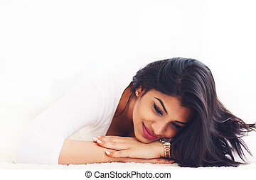 portrait of beautiful young indian woman on carpet