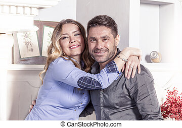 portrait of beautiful young loving couple in their home