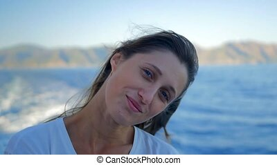 Portrait of Beautiful Young Smiling Caucasian Woman on the boat