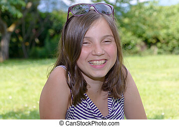 Portrait of beautiful young smiling teen girl, outdoor