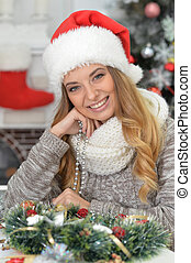 young smiling woman in Santa hat