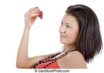 Portrait of beautiful young woman enjoy strawberry