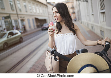 Portrait of beautiful young woman enjoying time on bicycle
