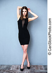 Portrait of beautiful young woman in black dress