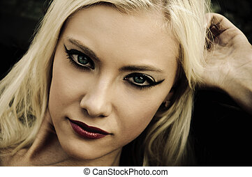 Portrait of beautiful young woman in noir style