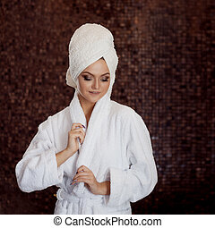 Portrait of beautiful young woman in Spa salon, close-up