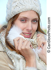 Portrait of beautiful young woman in winter