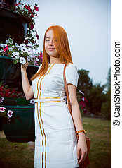 portrait of beautiful young woman in white dress